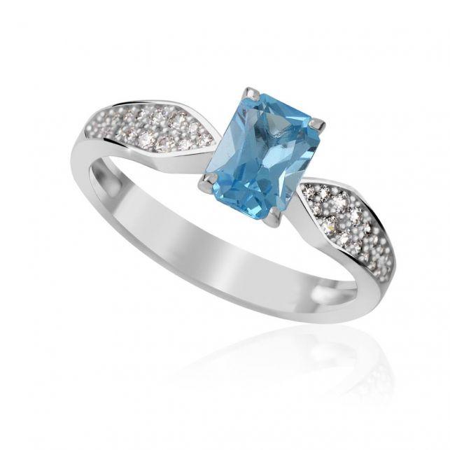 zlatý prsten s modrým topazem